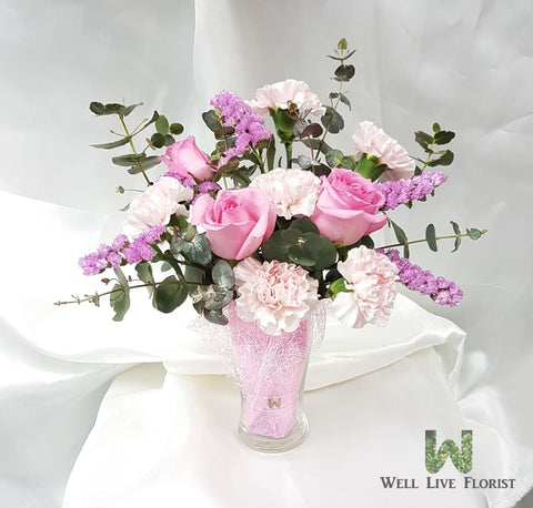 Table Arrangements of Fresh Cut Roses, Carnation and Dried Foliage In Clear Glass Ware