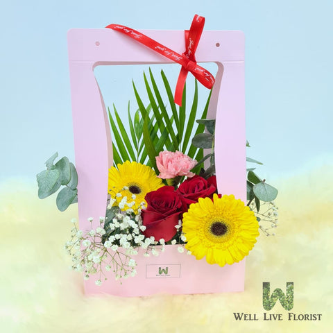 Flower Box Comprising of  Roses , Baby's Breath, Carnation, Gerbera and Foliage