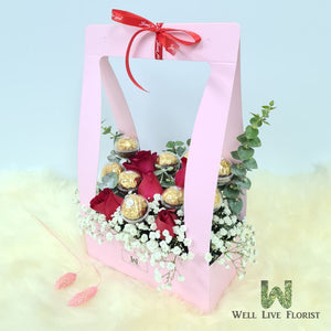 Flower Box Comprising of 05 Roses , Baby's Breath and Foliage With 09 Ferrero Rocher Chocolate