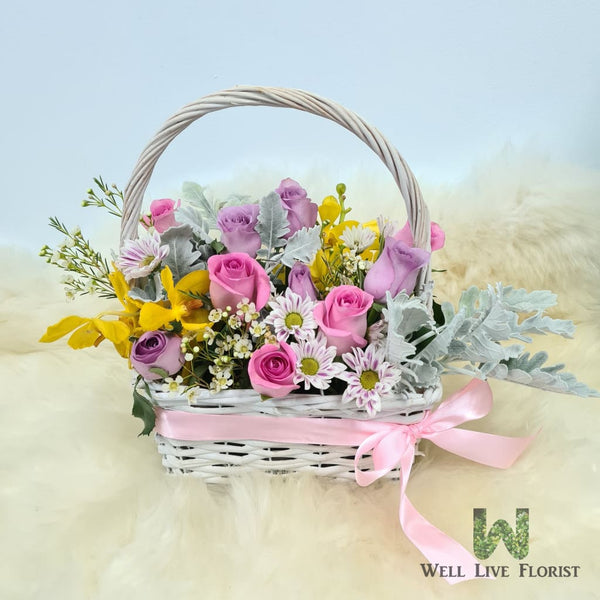 Flower Box Comprising of Roses , Orchid , Wax Flower , Pom Pom and Foliage