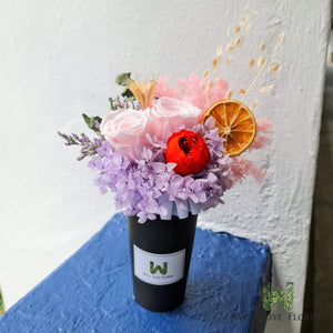 Flower cup Of Preserved Roses, Hydrangea, Dried Foliage and dried orange slice