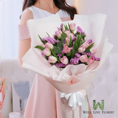 Hand Bouquet of Fresh Cut Pink Color Tulips
