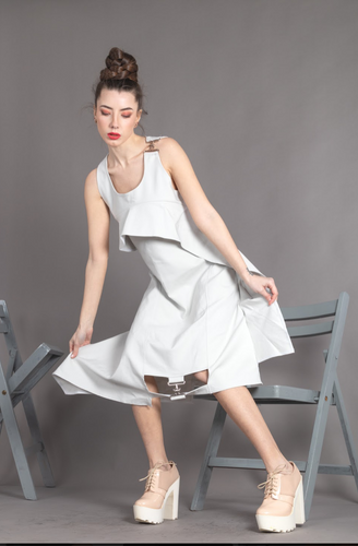 Sleeveless Dress whit silver buckle in front and on the arm
