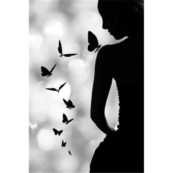 Silhouetted Woman and Butterflies