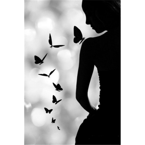 Image of Silhouetted Woman and Butterflies
