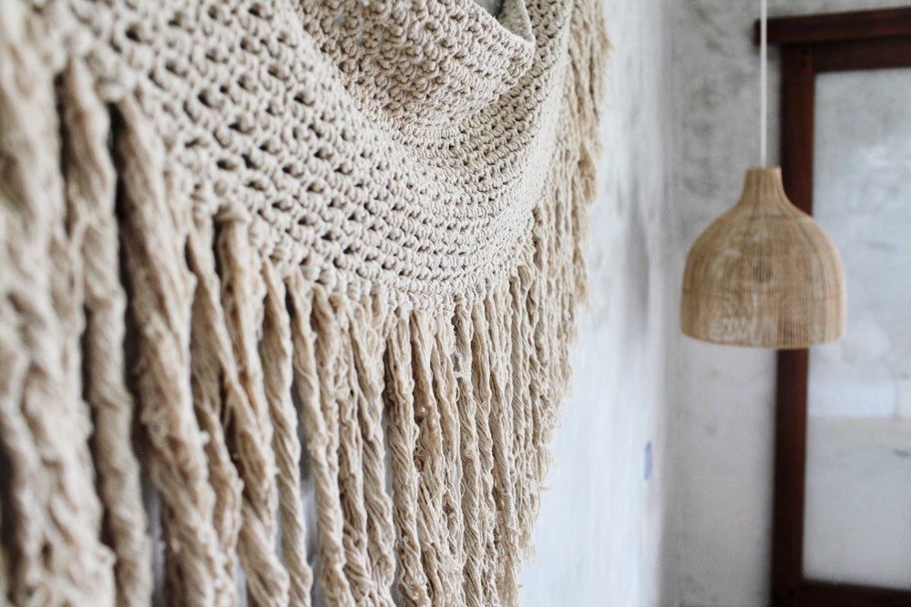 fringed macrame wall feature