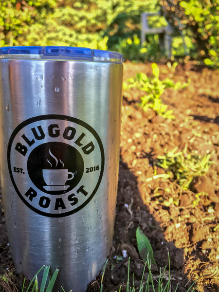 Blugold Roast Tumbler - Travel Mug, The power of [COFFEE] (front side) - Outdoors in Garden