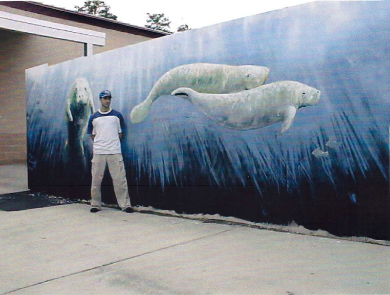 Rob Kaz with an early mural he painted.