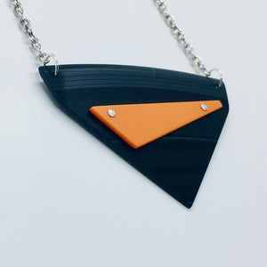 Black and orange riveted large necklace