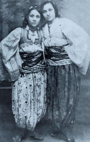 Anjezë left- Wearing traditional costumes