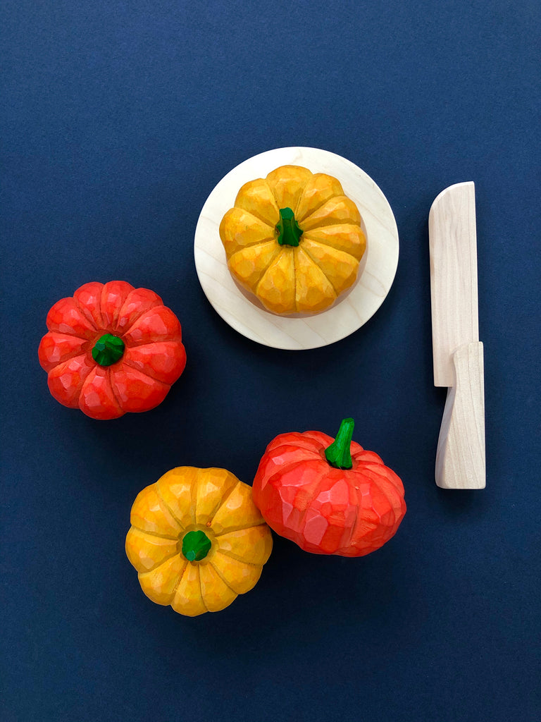 Hand-carved pumpkin wooden play food