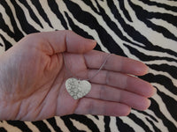 Paw print heart shaped necklace