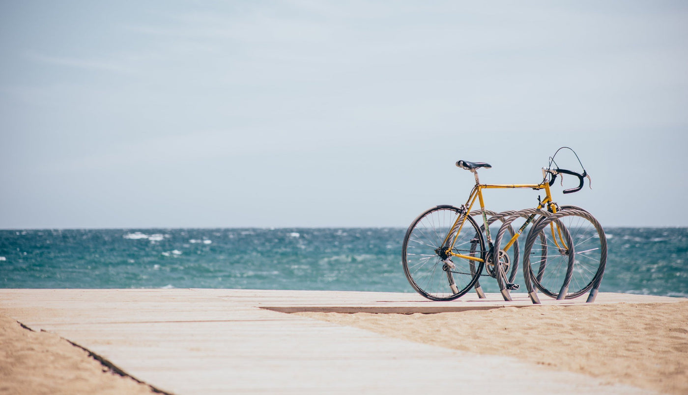 A used vintage bike on a boardwalk over looking the ocean.