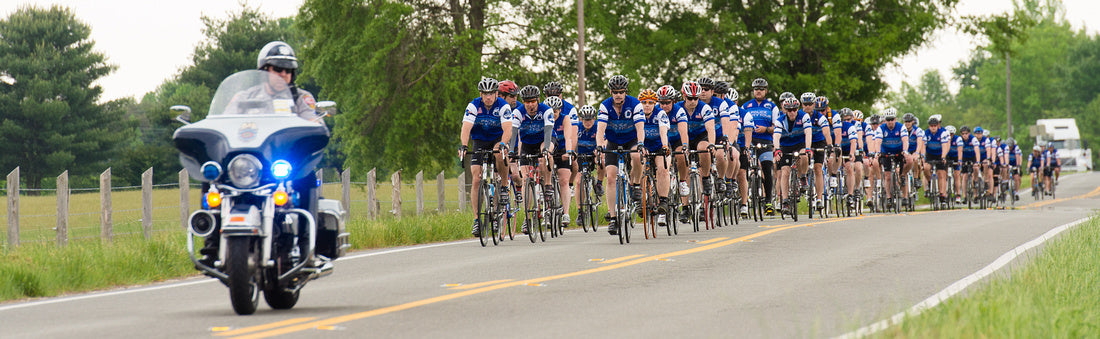 A Group of Police Unity Tour Riders wearing Bikeland's custom bike clothing