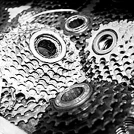 A picture of a bunch of bike gear cogs that represents us in an abstract Bikeland about way.