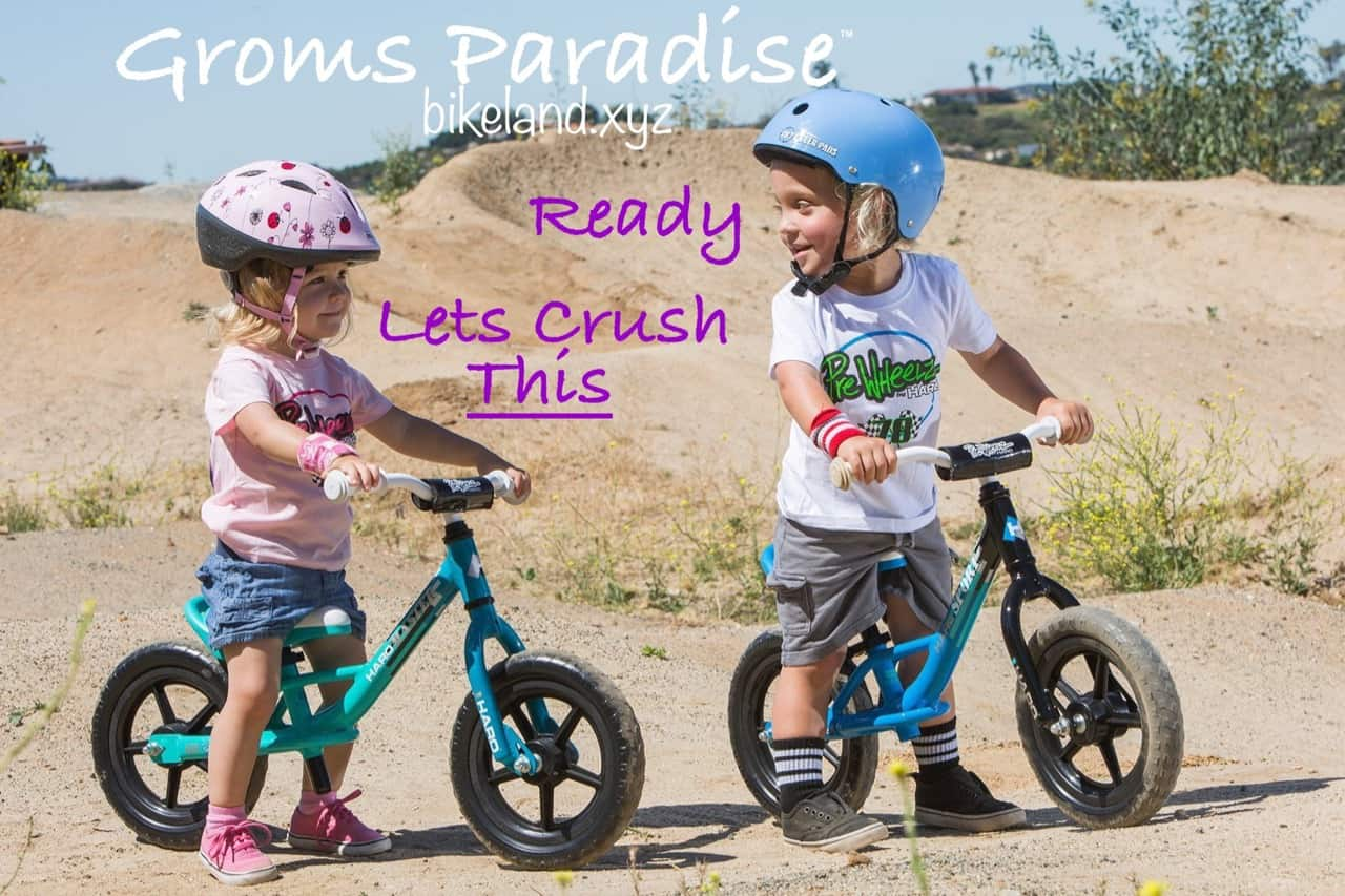 Two kids, a Girl and Boy sitting on Haro balance kids bikes at Groms Paradise bike track. One say's ready and the other replies, lets crush this.