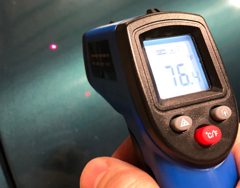 Infrared thermometer checking temperatures of a panel