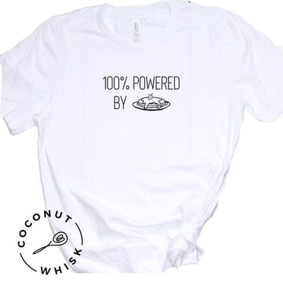 """100% POWERED BY PANCAKES"" Unisex T-shirt Coconut Whisk Baking Co."