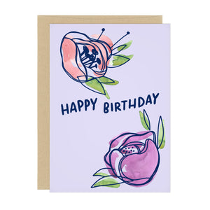 Birthday card with two watercolor flowers: one pink, one purple. Text reads: Happy Birthday