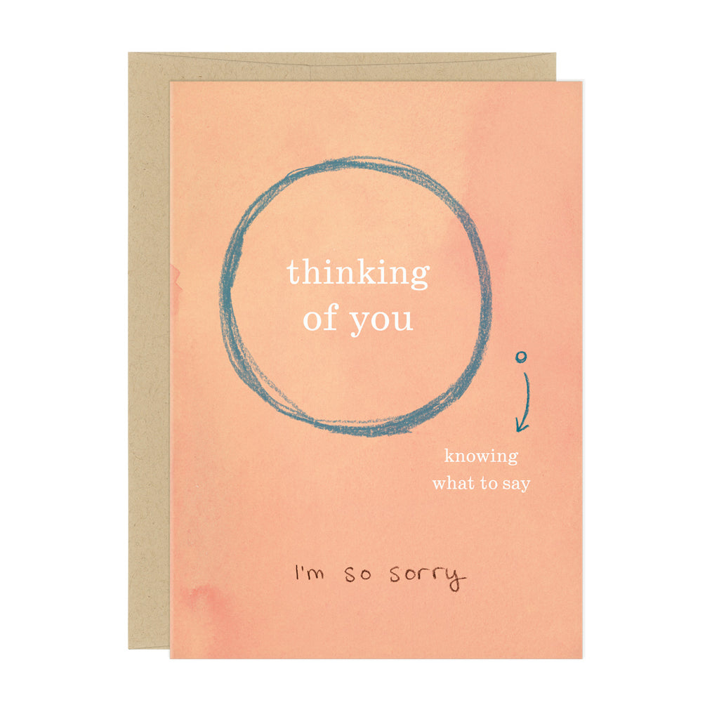 "Pale peach greeting card with a large venn diagram style circle, reading ""thinking of you"" a smaller circle says ""knowing what to say"". At the bottom of the card, text reads ""I'm so sorry"""