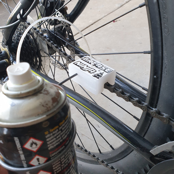 Grease Ninja connected to bicycle chain