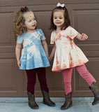 cute-fashion-twins-wearing-tie-dye-tops-from-the-painted-crane