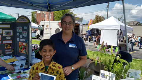 Kedar with his Penn State Ext Mentor Ms Consuelo Almovodar at the Belthlehem VegFest doing a Native Plant sale