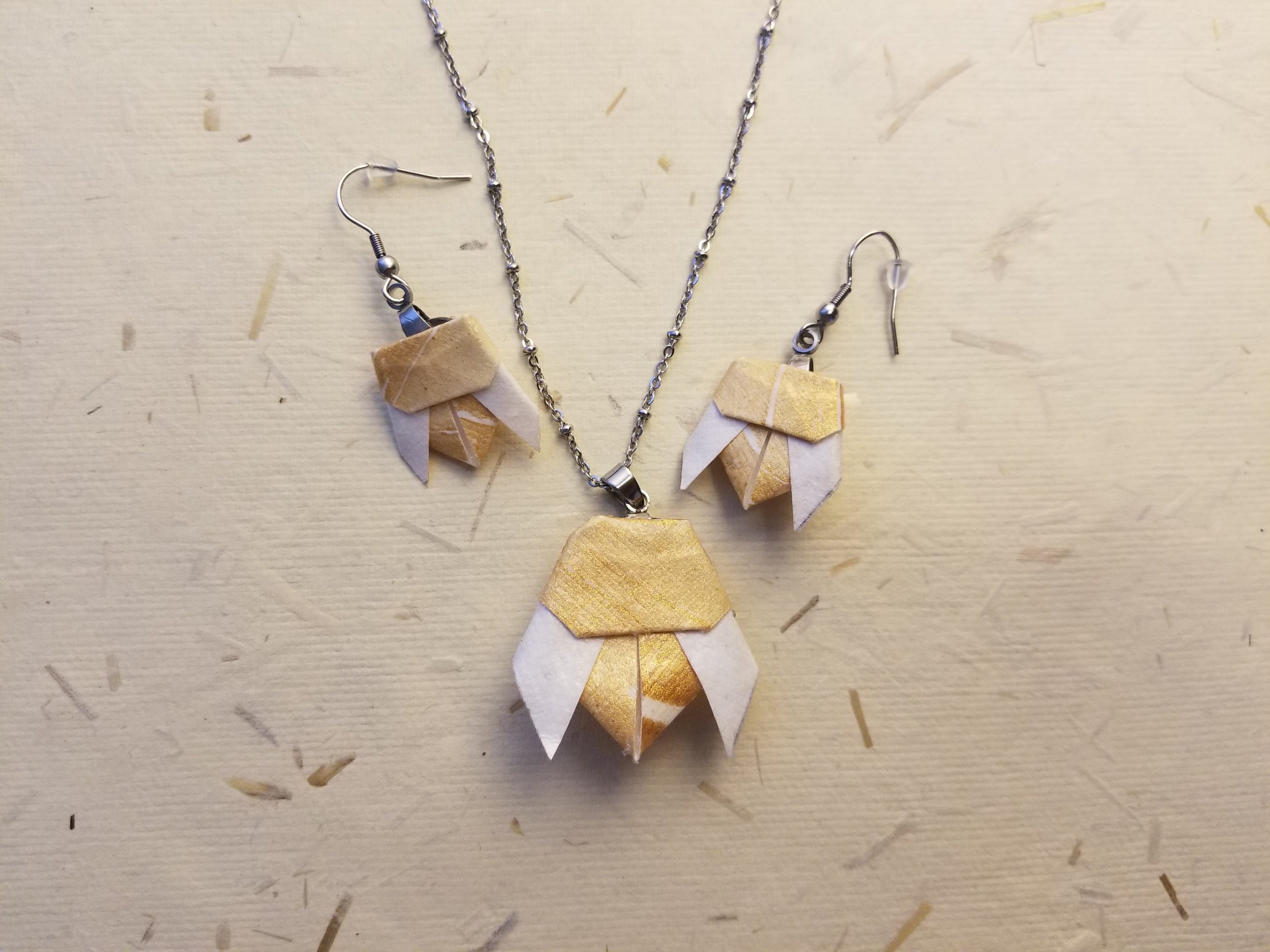 Hypo allergenic jewelry kit to make your own bee necklace and earrings.