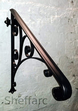 Wall mounted front steps handrail with ornamental scrolls. - www.sheffarc.com