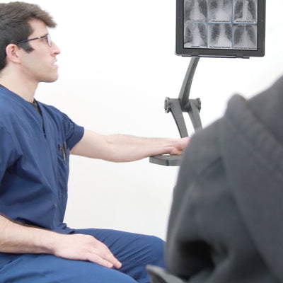 Image of a ZStand AllStar Pro being used in a doctors office to display information.
