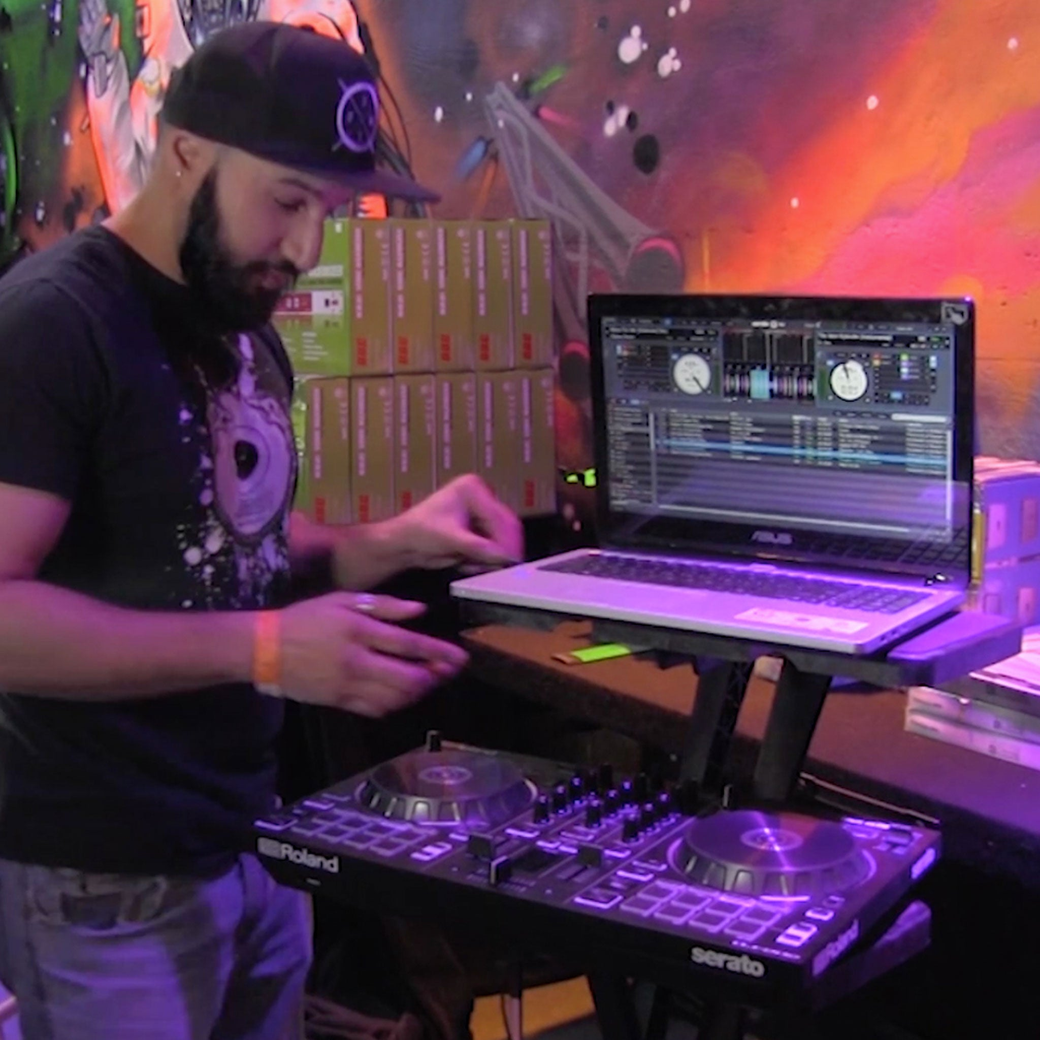 Image of a DJ using the ZStand Double Decker to hold his laptop and turn-tables.