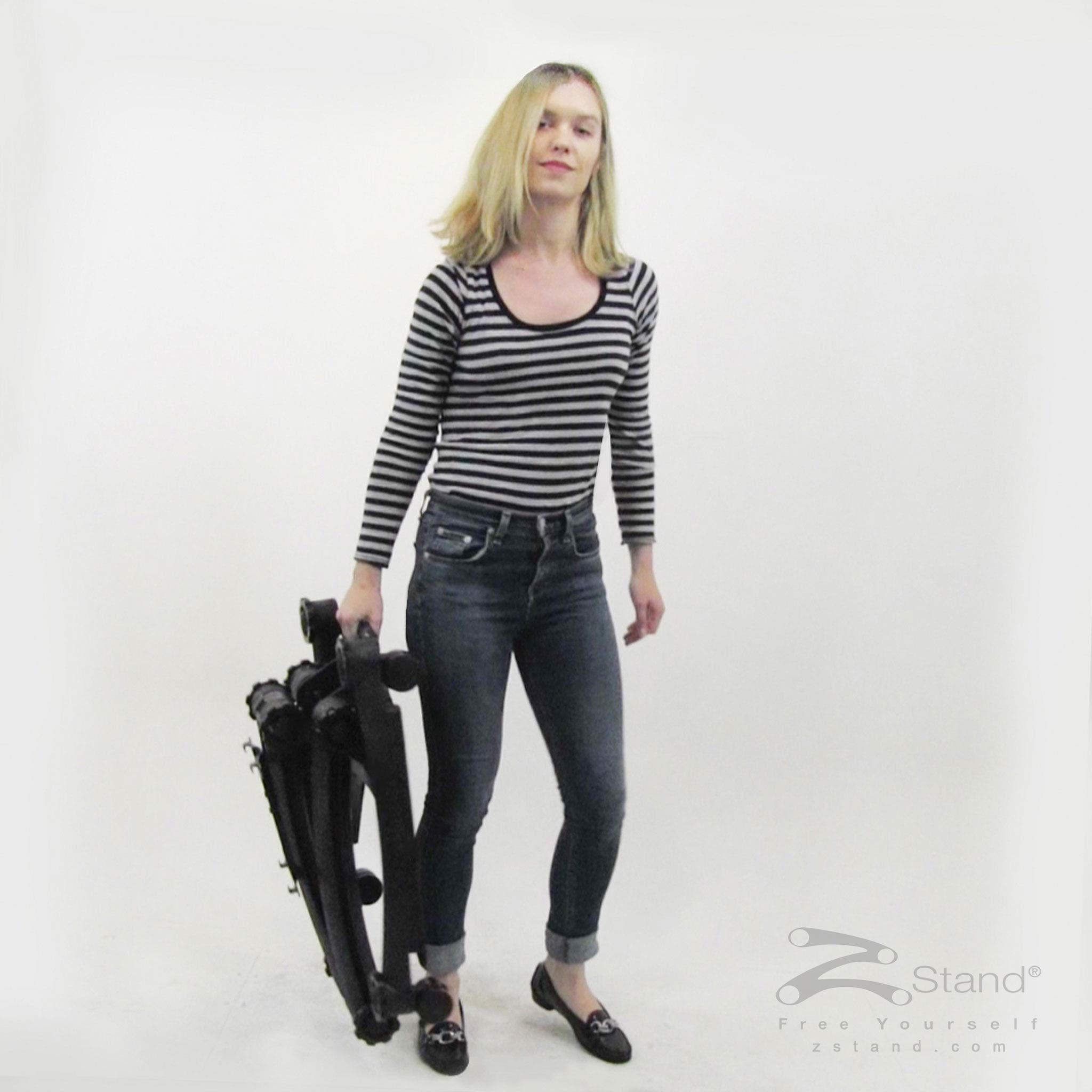 Image of a woman carrying the ZStand Sportster to transport it somewhere else easily.