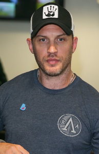 TOM HARDY WEARS LUCKY SEVEN TRUCKER CAP