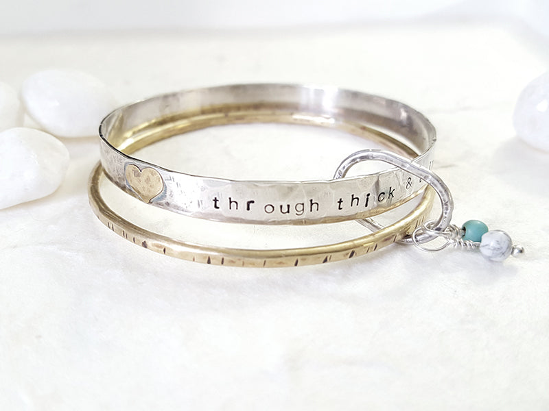 Through Thick and Thin bangle set sterling silver and brass custom personalized Christina Guenther Jewelry