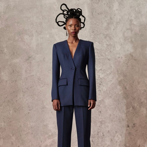 MmusoMaxwell Asymmetric Cropped Jacket is an intricately designed, two-tone outerwear piece with an asymmetric cropped cut.
