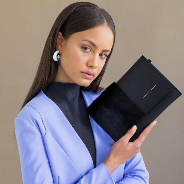 Thalia Strates Mali Blue Clutch/Belt Bag is a dual-purpose bag with a detachable wrist strap and removable belt.