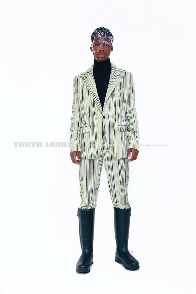 Tokyo James Autumn-Winter 2020 tailored green pinstripe suit and black turtleneck and Ariat Europe outerwear boots