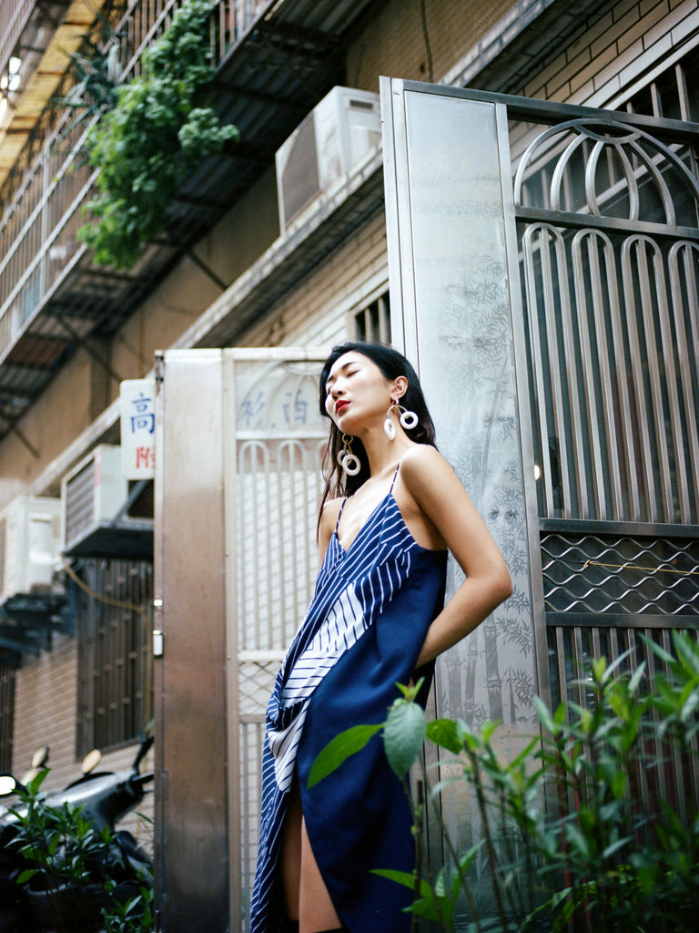 Model Ting Ting in Taipei, Taiwan wearing South African fashion brands MmusoMaxwell and Pichulik for The Folklore