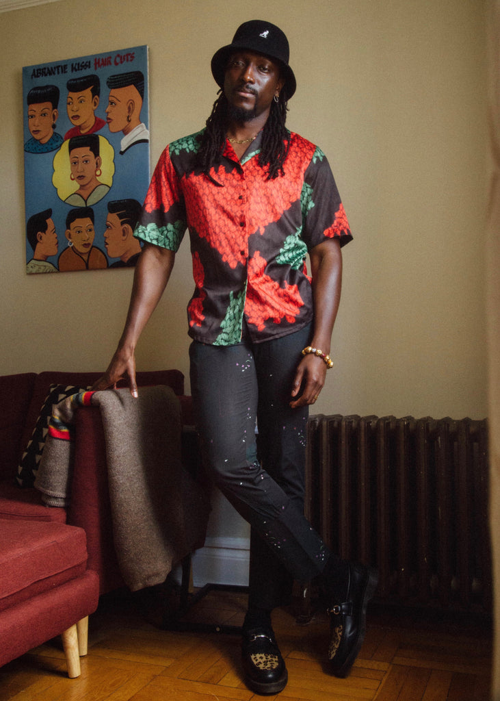 Photographer Joshua Kissi wearing luxury African fashion brand Orange Culture