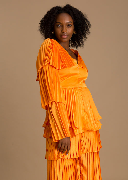 Orange long sleeve pleated top