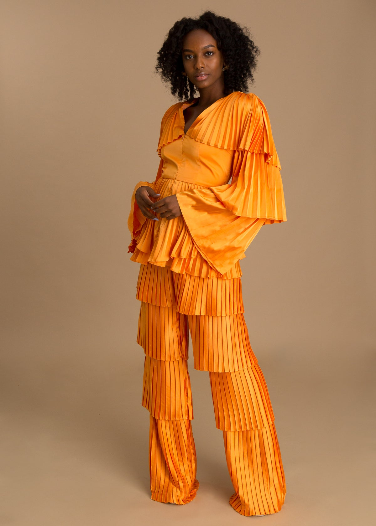 Orange pleated high-waisted pants