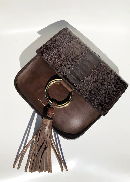 Shop small brown handmade leather bag with ostrich shin and detachable tassel from Thalia Strates.
