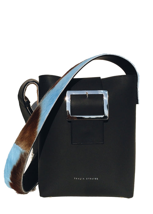 Shop the medium sized black handmade leather bag with a springbok fur strap from Thalia Strates.