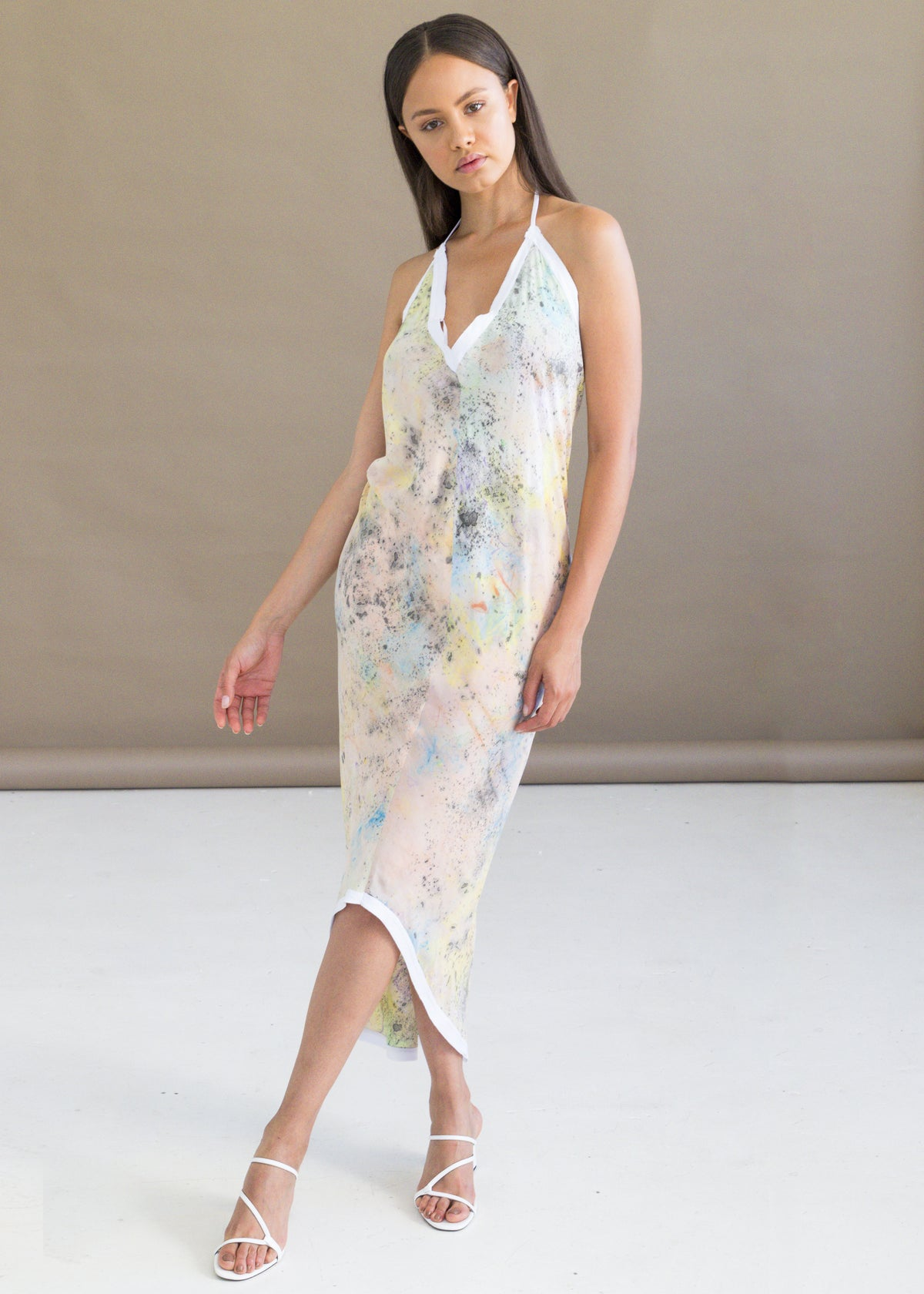 Shop the hand-dyed halter dress featuring a pastel print design by W35T.