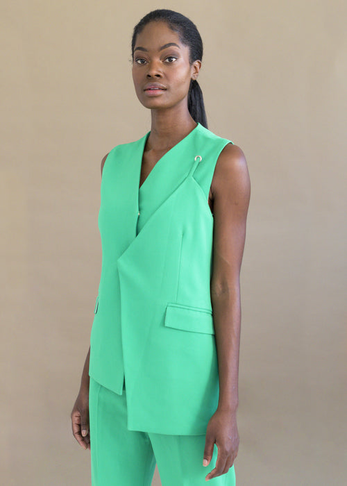 Shop the neon green sleeveless layered vest with pockets by MmusoMaxwell.