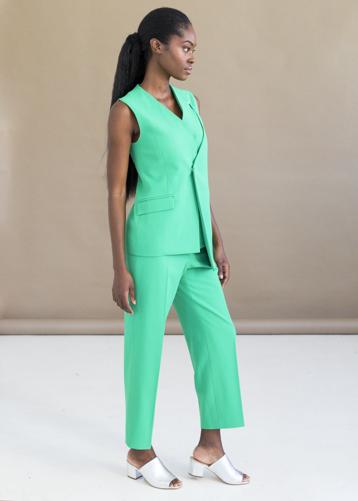 Shop the neon green tailored pants with pockets by MmusoMaxwell.