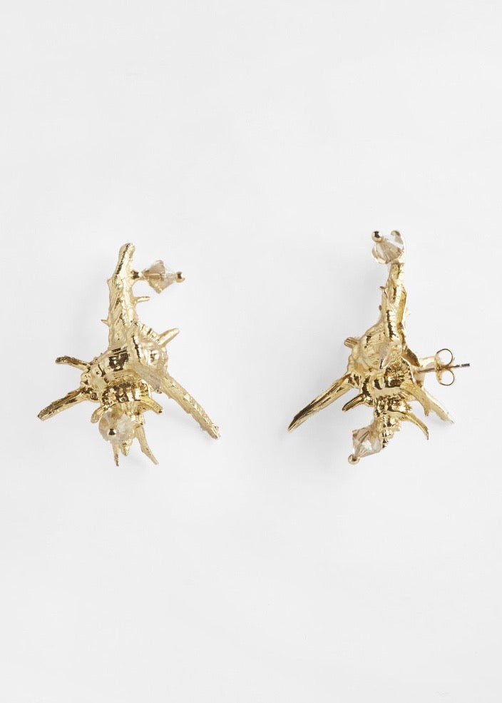 Shop the handmade brass, 22k gold plated earring studs embedded with crystals from Pichulik