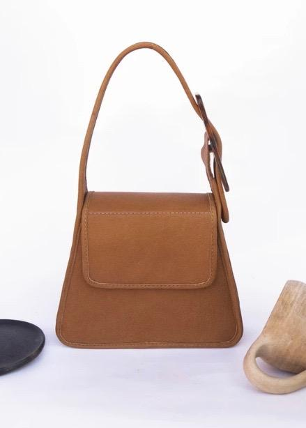 Tan leather bag with tortoise buckle