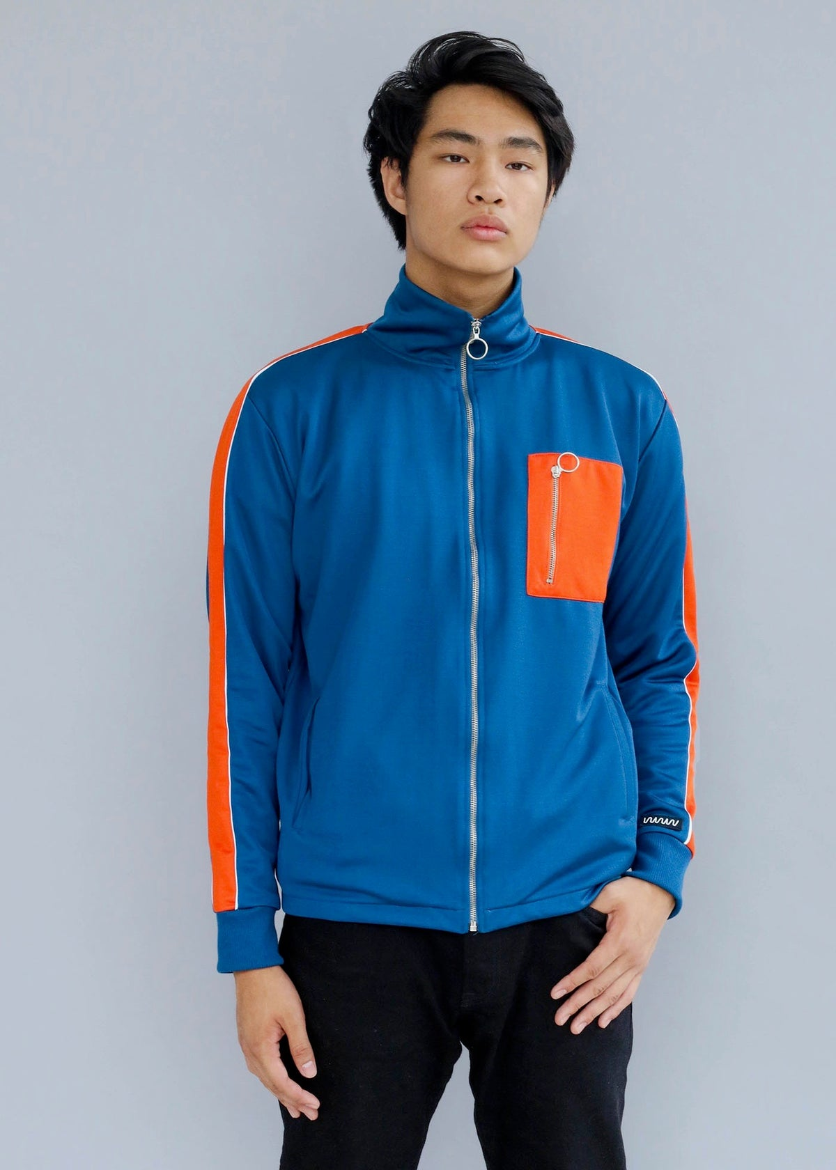 Orange and blue Vertical Tracksuit Jacket featuring a high neckline from What We Wear