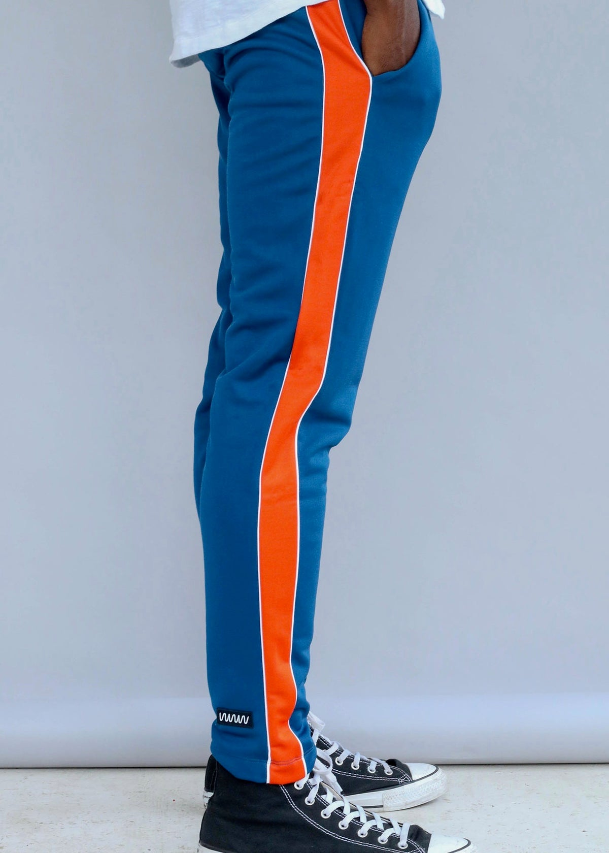 Orange and blue Vertical Tracksuit Pants featuring an adjustable waist from What We Wear